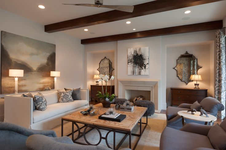 David James Custom Builders Elegant Living Room Features Stained Wood Beams Over Black And