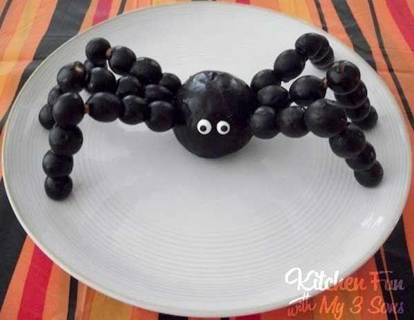 Just with fruit, pretzel sticks and edible eyeballs to make this spooooooooky spider snack.