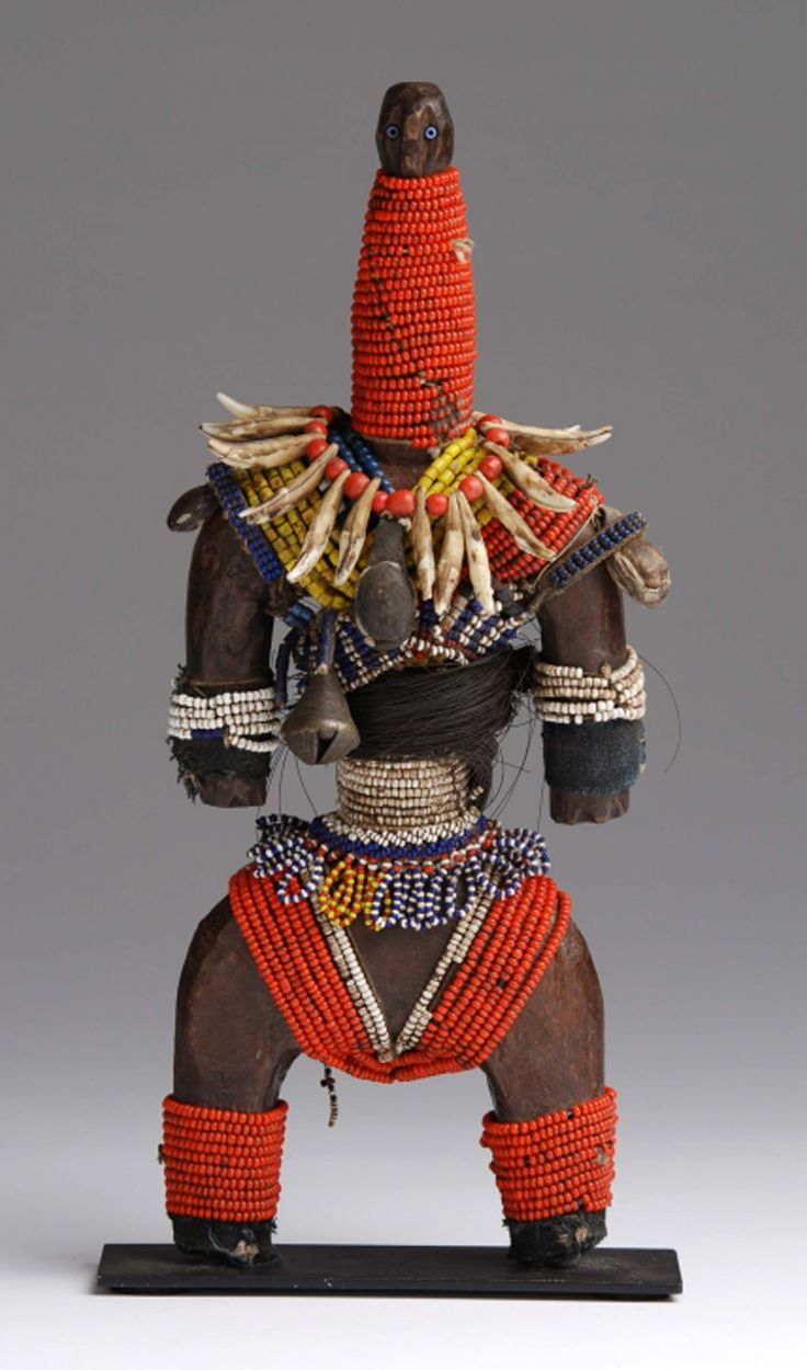 Africa | Doll from the Namji people of northern Cameroon | Wood, glass beads, cowrie shells, animal claws, fur, leather and metal