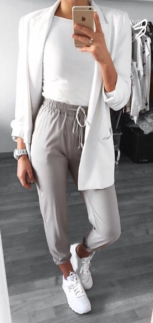 Such a comfy but cute outfit with grey satin joggers and white trainers