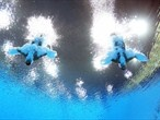 An underwater camera captures Francesca Dallape and Tania Cagnotto of Italy as they enter the pool