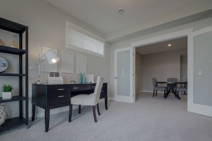 The office in the basement is an awesome place to get a little work done in peace and quiet. We love the double doors so you can open up the space if you want to!