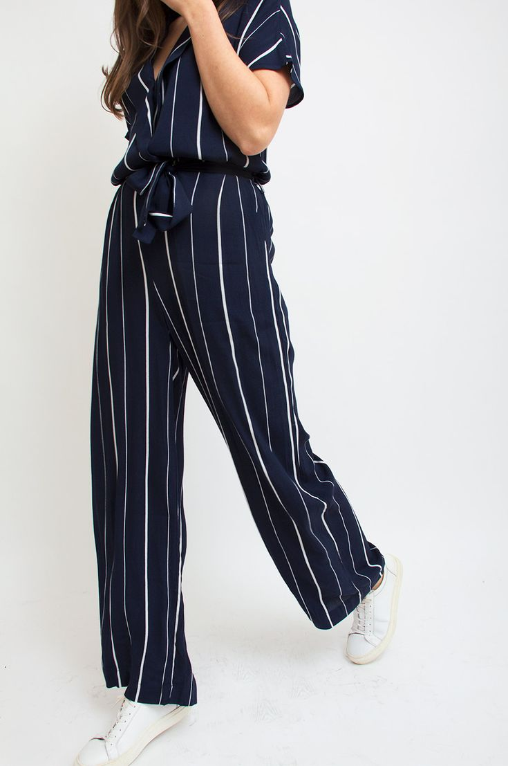 This pyjama-inspired jumpsuit comes with a rich navy base and is decorated with lengthening cream stripes. We love the short-sleeved silhouette and loose fit for a laid-back yet chic statement. Team yours withpumps for a night out. By Selected Femme.
