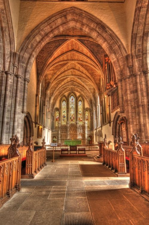 Brecon Cathedral in Wales (1093) began as the Benedictine Priory of St John the Evangelist, built by the Normans on the site of an earlier Celtic church. At the dissolution of the monasteries in 1537 it became Brecon's Parish Church. It became a Cathedral only in 1923, on the establishment of the Diocese of Swansea and Brecon. Although a building of relatively modest proportions, the Cathedral is set in a walled Close, unique in Wales.
