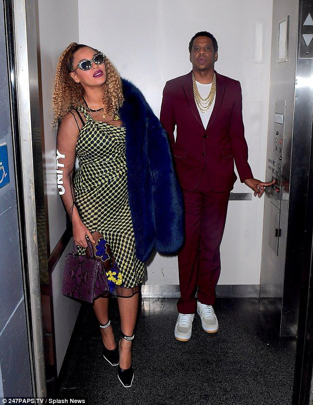 21c49d56900 Staying together: Jay Z dressed up in a maroon suit, adding a white top and  sneakers with layers of gold chains