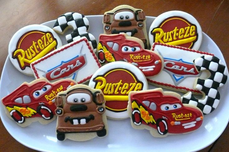 """Walt Disney """"Cars"""" decorated cookies to be used as favors for a birthday party...Lightning McQueen, 'Mater.  www.facebook.com/cookiesbycharity"""