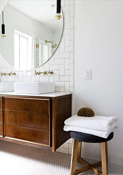 Dark wood vanity, round mirror, white subway tile, hex tile bathroom