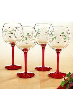 Etched and hand painted with a festive pattern of holly and berries, these red-stemmed Winterberry wine glasses from Pfaltzgraff make a merry impression at your holiday table. | Glass | Hand wash only