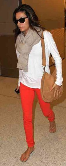 Great scarf and orange jeans