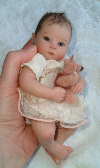 So sweet!  Baby made of polymer clay by Kim van de Wetering; This is beautiful AND looks like one of my babies.