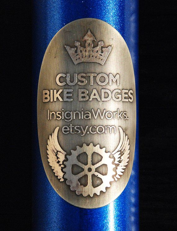 This is a custom, acid-etched bicycle badge. Each one is made to order and is a one-of-a-kind. You can personalize one of my existing designs,