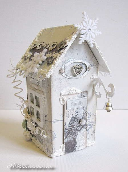 A winter house. It's a MAya Road chipboard house with a mini album