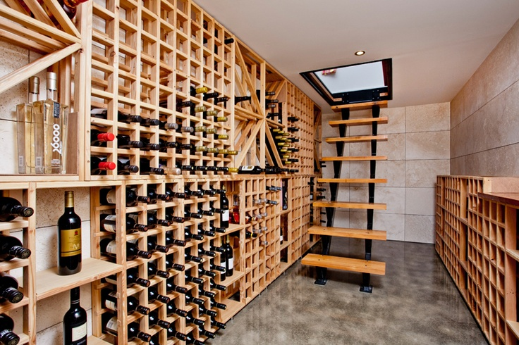 Wine cellar accessible from trap door in the kitchen floor in Bungalow Renovation by Haven Renovations www.havenrenovations.co.nz