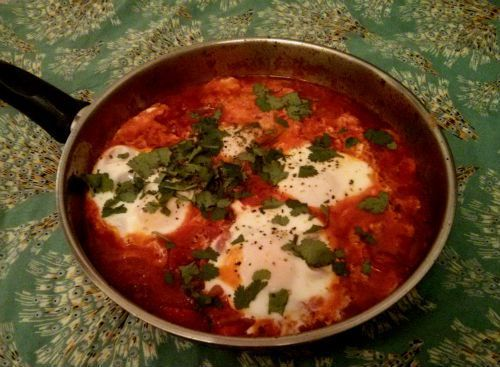 Eggs poached with n'duja peppers and tomatoes