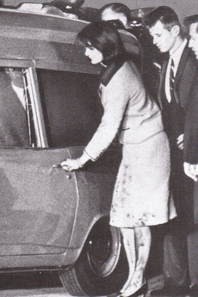 Jackie Kennedy getting into the hearse with her deceased husband still wearing the blood stained clothes.
