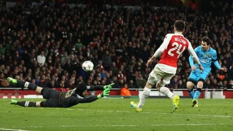 Lionel Messi puts Barcelona in front at Arsenal in the Champions League last-16 first leg at the Emirates