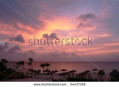 Aruba, Dutch Caribbean. Sunset on the beach by Adriano Castelli, via ShutterStock