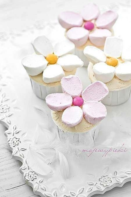 Marshmallow Flower Cupcakes. Garden Party Food Idea.  Make sure you go to emykitchen.com to see if there are any recipes you are interested in!
