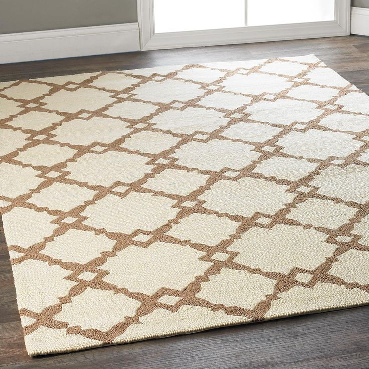 Spindle Squares in Taupe Indoor Outdoor Rug Squares with an interesting spindle shape detail, form a diamond trellis pattern in neutral taupe on ivory. This transitional geometric rug is appealing for inside or out, with easy care qualities and high performance wear. Hand hooked loops of polypropylene fiber are specially engineered to remain vibrant, resisting the elements from UV rays to rain.
