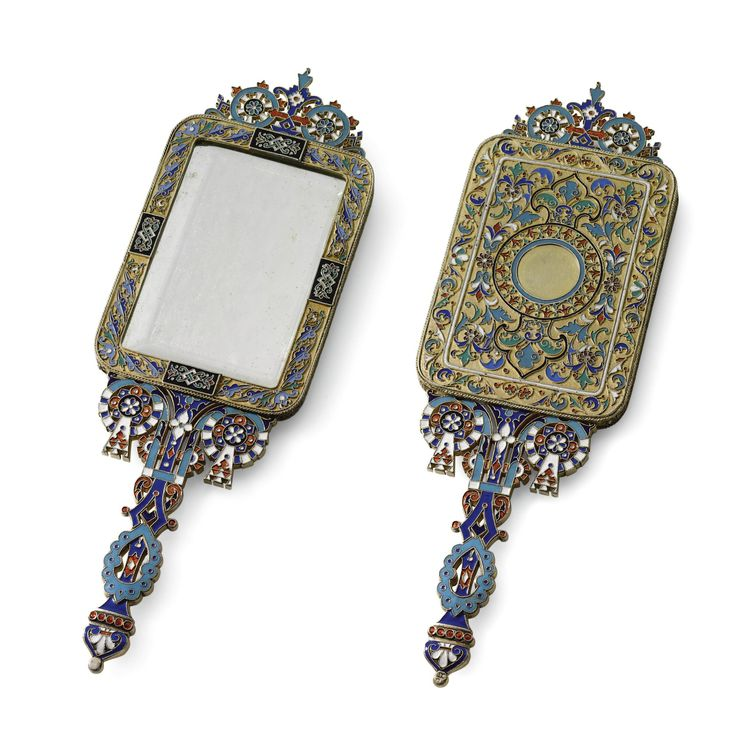 A SILVER-GILT AND CLOISONNÉ ENAMEL MIRROR, OVCHINNIKOV, MOSCOW, CIRCA 1890  rectangular, the centre and the borders decorated with scrolling foliage, the handle and the finial enamelled in translucent and opaque Pan-Slavic motifs | JV