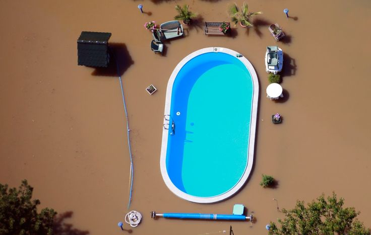 Photo: Thomas Peter / Reuters  A garden with a swimming pool is inundated by the waters of the Elbe River during floods near Magdeburg in the state of Saxony Anhalt, on June 10, 2013.  Tens of thousands of Germans, Hungarians and Czechs were evacuated from their homes as soldiers raced to pile up sandbags to hold back rising waters in the region's worst floods in a decade.