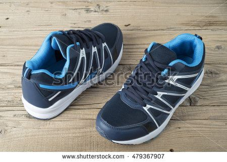 Pair of running shoes on old wooden table
