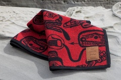 """Haida Dream Time"" blanket by James Hart.  This wonderful creation entitled ""Dreamtime"" by James Hart shows classic Haida images in bold red and black colors, which are traditional of this native art form. An Italian Jacquard weave, this wool blanket offers richness of color and design.  $150.00"