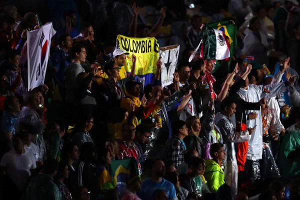 Spectators cheer during the Closing Ceremony on Day 16 of the Rio 2016 Olympic…