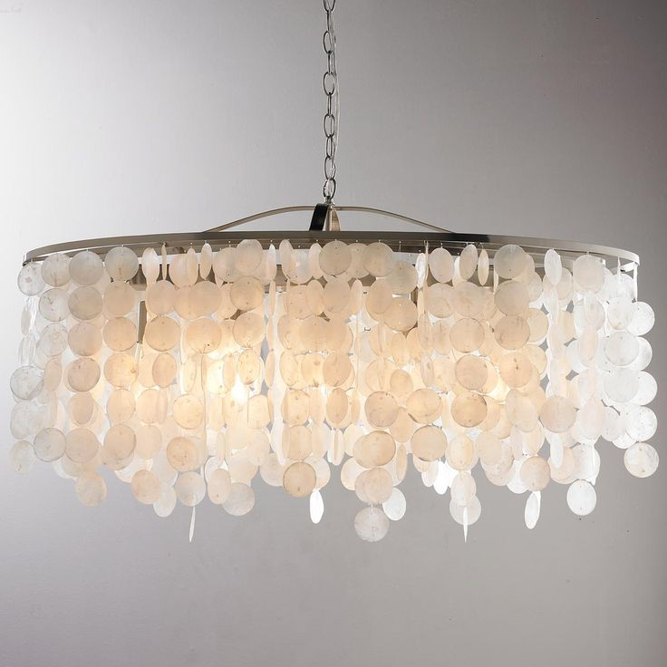 "Modern Capiz Shell Linear Chandelier This beautiful linear chandelier has a Satin Nickel finish to complement rows of dangling Capiz shells. Pair this linear chandelier with modern or transitional home decor pieces for a glamorous look. 5x60 watt medium base lamp. (13.5""Hx35.75""W) 15"" Extension."