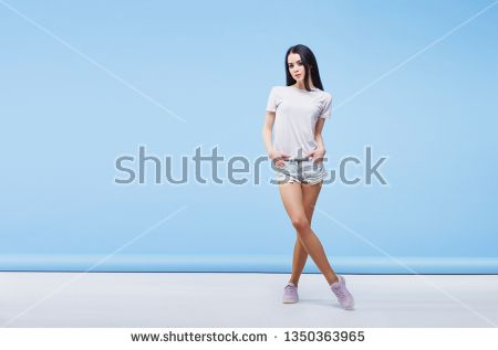 83e2308aae Stock Photo  Amazing woman in white T-shirt and denim shorts. Smiling  beautiful