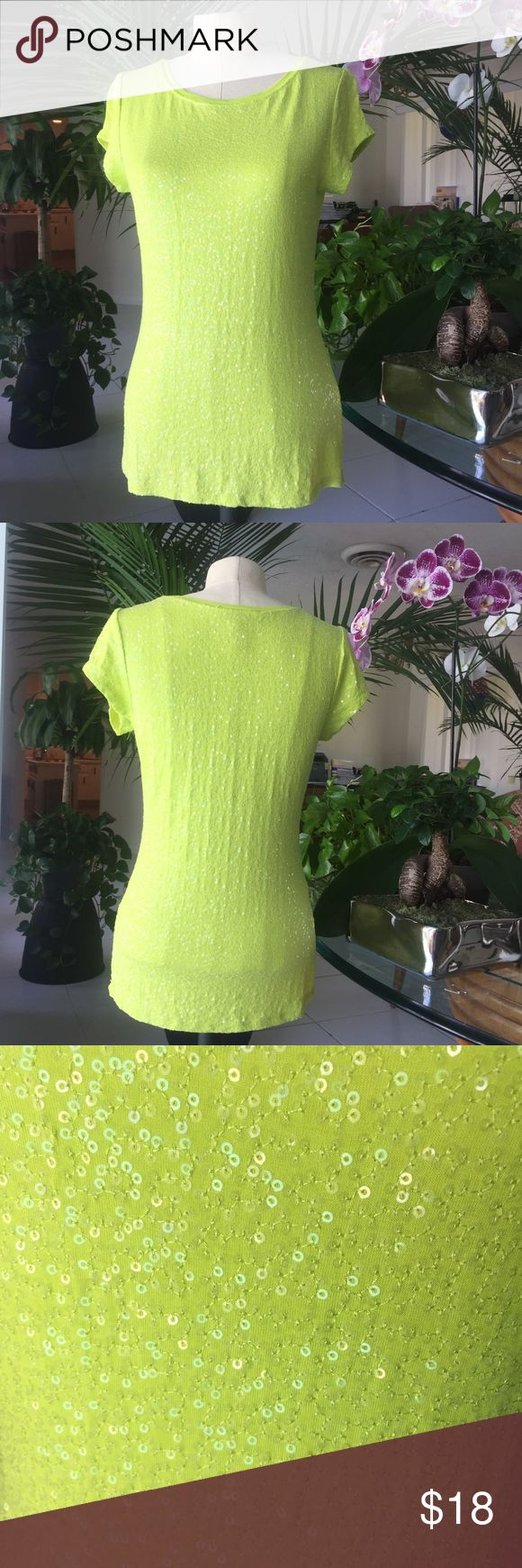 Lime green sequin Tee-shirt Unique lime green tee-shirt , short sleeves , made entirely of sequins from a INC International Concepts , size M , perfect for a stroll around the mall during the day or wear it with a nice pair of jeans and a coat for a stylish girl's night out . Previously owned , perfect condition , comes from a non smoking home . INC International Concepts Tops Tees - Short Sleeve