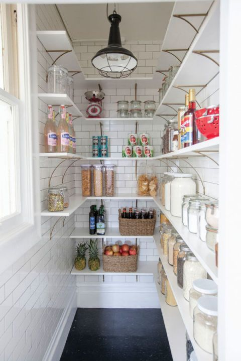 You can't go wrong with this classic design. Jordan of Oh Happy Day added subway tiles, white bracket shelves, and a black pendant to complete the industrial-inspired look of her pantry. See more of the makeover »