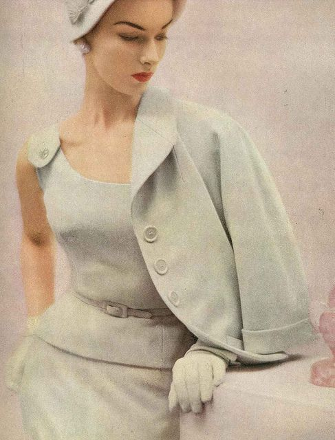 Oh I love this suit  - the pinafore style detailing of shoulder buttons, the skinny belt, jacket and hat!    February Vogue 1953    Adele Simpson  'White heather' pure wool suit.