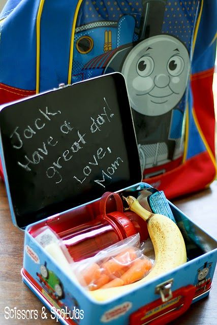 Chalkboard paint on the inside of a lunch box. Great way to leave a note for your little one. <3