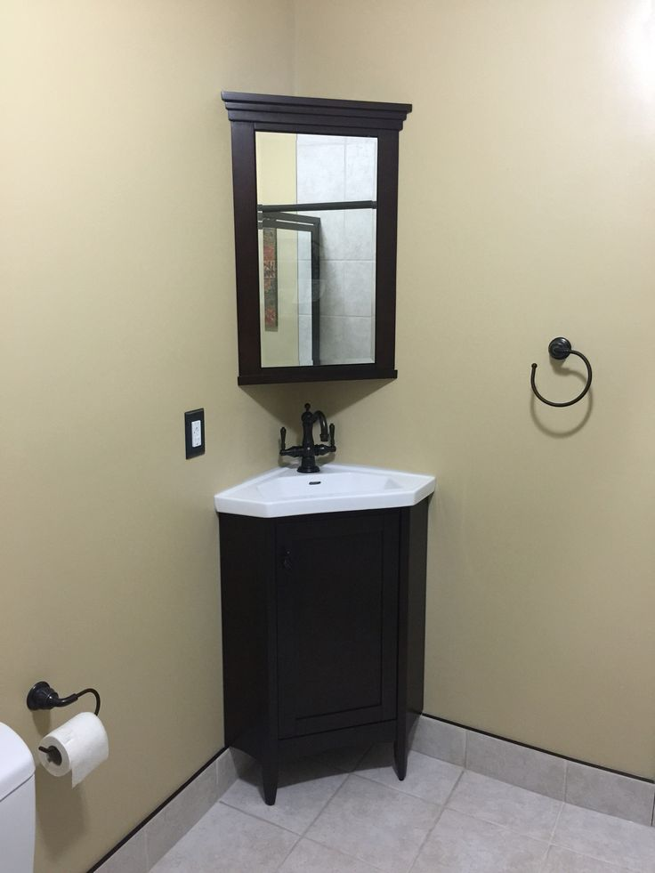 On this renovation we installed a corner cabinet with a corner medicine chest. All hardware was in oil rubbed bronze.