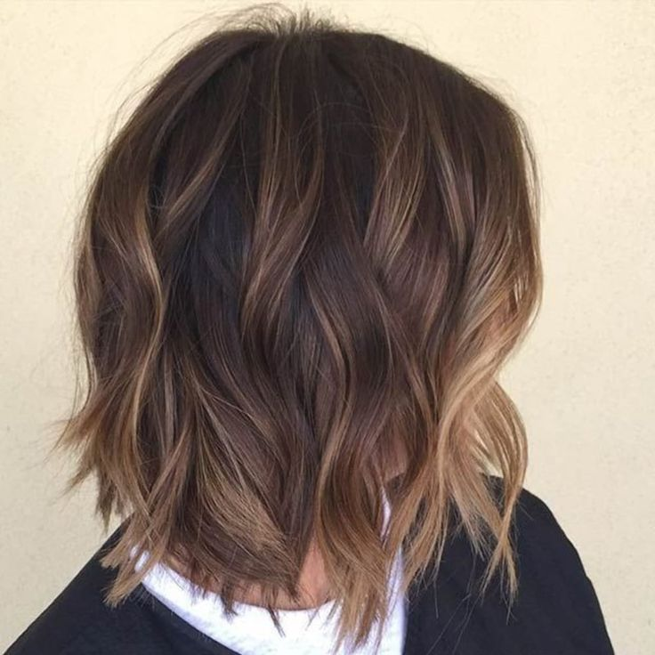 shaggy brown bob with subtle balayage highlights. Natural looking, sophisticated and exquisite.