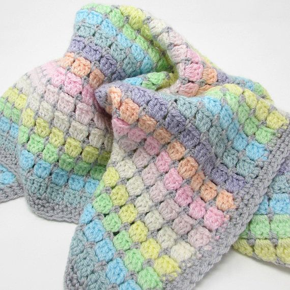 Crochet a beautiful pastel rainbow cot blanket. Easy and fast to make - the perfect gift for a baby shower or newborn. #crochet #babygift #babyshower #easycrochet #babygirl #babyboy