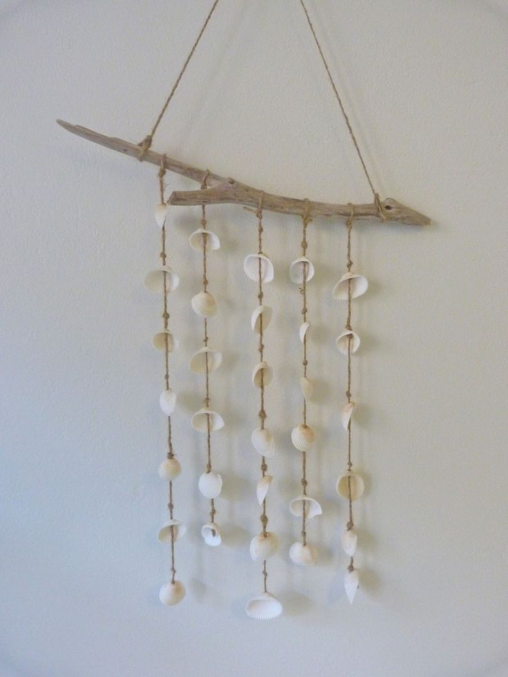 Best 25 seashell mobile ideas on pinterest shell wind for Shell wind chimes diy