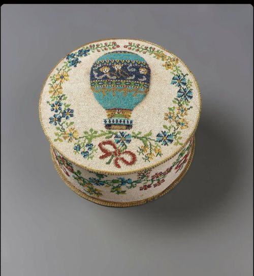 Round beaded box with balloon inside floral wreath, made in France, 1785-1800: