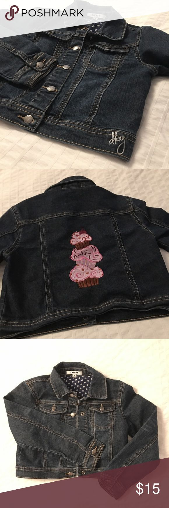 "💖 Girl's DKNY Jean Jacket Super sweet jean jacket for a young girl, with embroidered cupcakes on the back! 😍 Put your cutie in some bright skinny jeans and flats and a tshirt with this jean jacket and she's looking adorable! Hardly worn, clean and in LIKE NEW, EXCELLENT condition. 💗  👔Materials 100% Cotton  📏Size/Measurements M (Girl) • Shoulder to Hem: 13"" • Arm Length: 19.5"" • Pit to Pit: 14""  🌟Bundle 2 or more items and save 15%!  📸 Follow me on Instagram @cubbycreekboutique DKNY…"