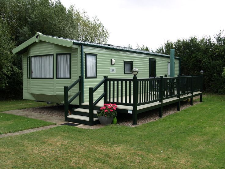 Fensys dark green foiled hand railing with beige deck board on Wilerby static caravan holiday home