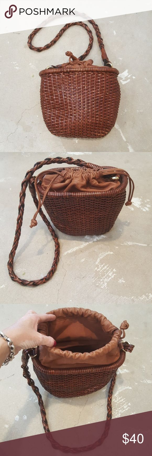 "Talbots Genuine Leather Bucket Bag I am selling a stunning and unique, Talbots bucket bag.  This is genuine ""woven"" leather in the prettiest brown hue.  I adore the shape this bucket bag hold regardless of what is placed inside, and the adjustable ""slouchy"" top adds icing to an already stellar design cake!!  Excellent condition with iminmal interior wear, outside is great. Talbots Bags Hobos"