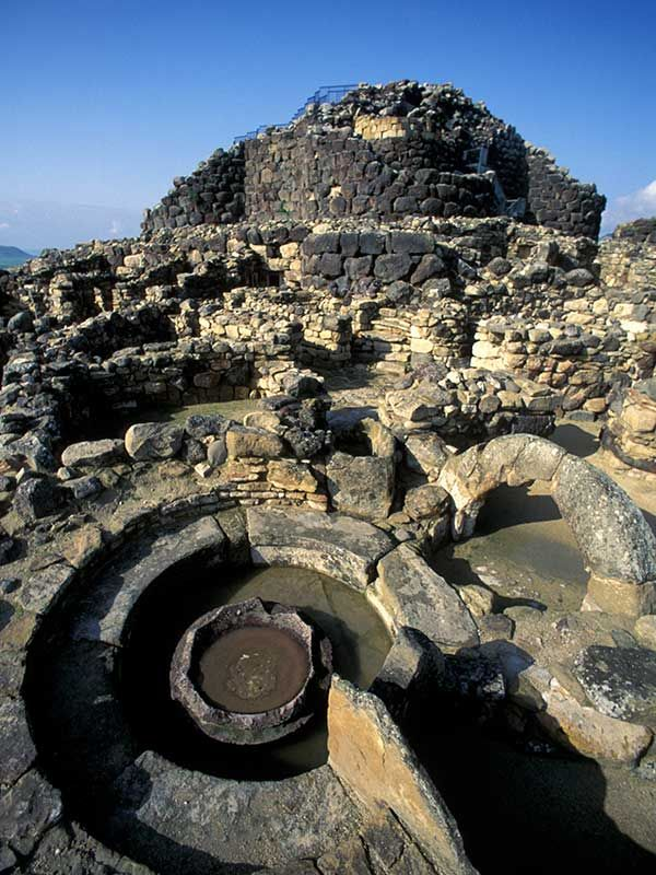 SU NURAXI DI BARUMINI, Italy: During the late 2nd millennium B.C. in the Bronze Age, a special type of defensive structure known as nuraghi (for which no parallel exists anywhere else in the world) developed on the island of Sardinia. The complex consists of circular defensive towers in the form of truncated cones built of dressed stone, with corbel-vaulted internal chambers.