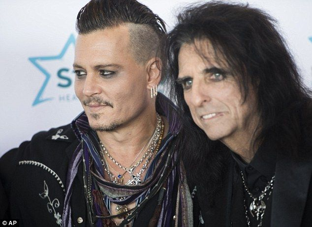Focused on work: Johnny Depp and his Hollywood Vampires bandmate Alice Cooper arrived at the Starkey Hearing Foundation gala in Minnesota on Sunday evening