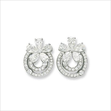 A Pair of Diamond Ear Clips, by Bulgari