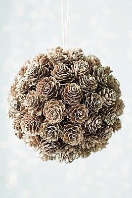 ~ Pinecone Kissing Ball ~ Love this! It looks easy to make, too. All you have to do is hang a styro foam ball and then hot glue the pinecones to it. And you could just dust it lightly with paint to get that frosted look. Love it.