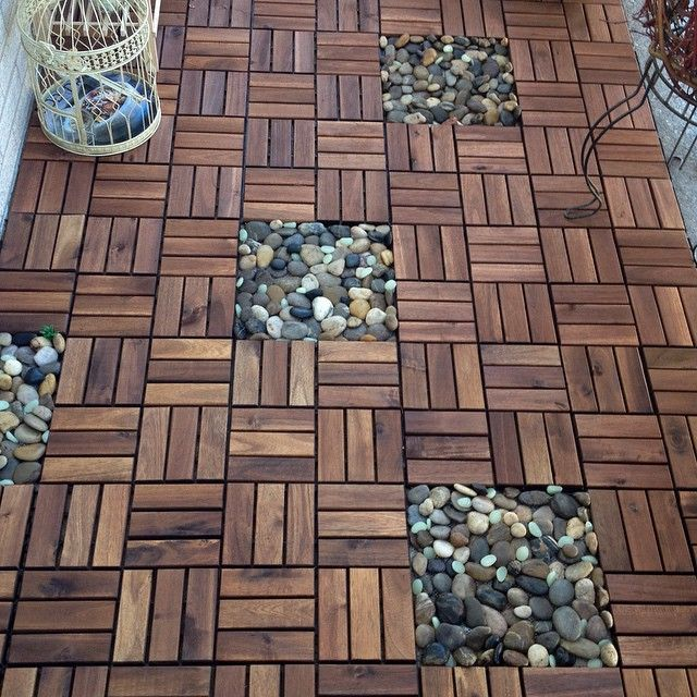 """Pinner said: """"Our 70 square feet balcony floor makeover under $180. IKEA deck tiles with river rocks from dollar store = beautiful balcony floor for outdoor space. So easy to install and remove later if you are a renter"""""""