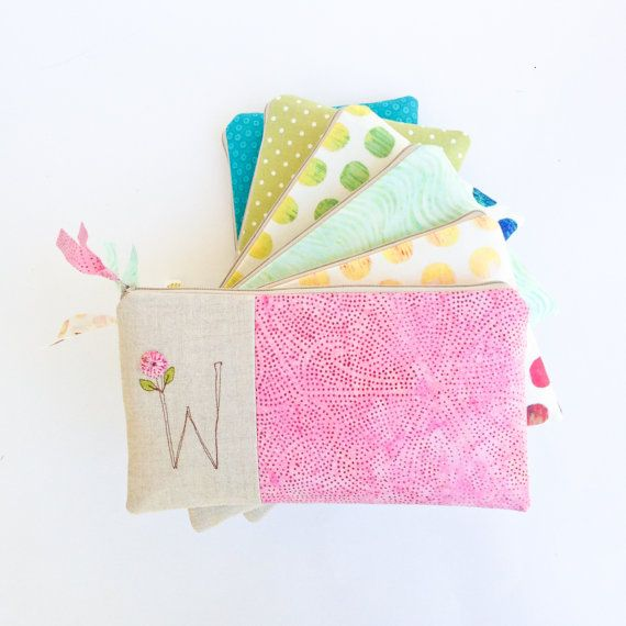Make each of your bridesmaids beam with joy when they receive this colorful clutch with stitched monogram that they can use beyond your wedding