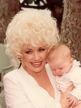 Dolly Parton - What a talent! THE most prolific woman song writer ever AND married to the same man for over 45 years. Wow!