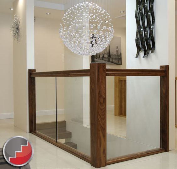 I love the Black walnut handrail and newel posts with the Glass Balustrading: